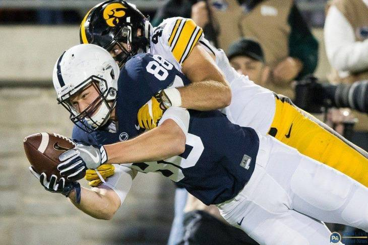 de3caf85c69e2dcc1082_Mike_Gesicki_stretching_vs_Iowa.jpg