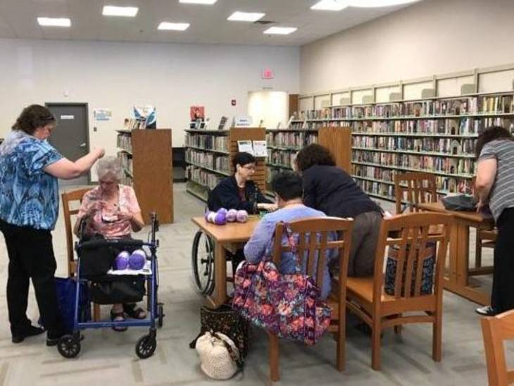 e0480beab918023dc6bf_Needlework_Participants_Inside_Library.jpg