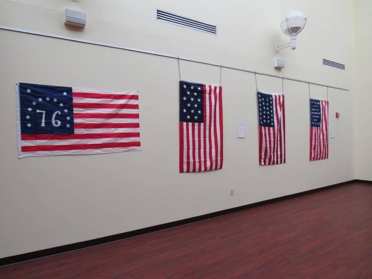 e4c6a2489aa84a476633_American_Flag_Display__1_.jpg