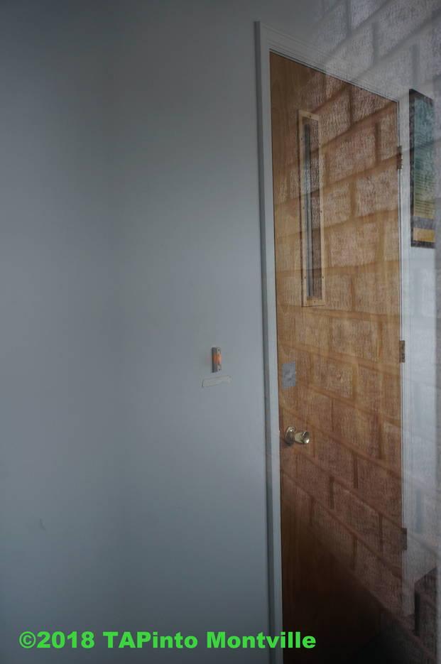 e4c92a1c1f8b0f92e5be_a_The_inner_door_with_a_doorbell_of_Swan_Lake_Spa_in_Pine_Brook__2018_TAPinto_Montville.JPG