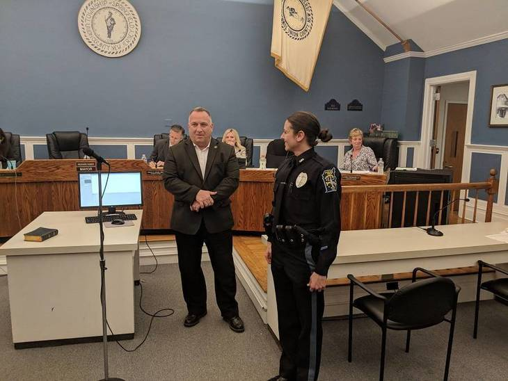 e56cc01011350749ec3c_Police_Chief_Cook_welcoming_Michelle_DiParisi_to_the_department.jpg