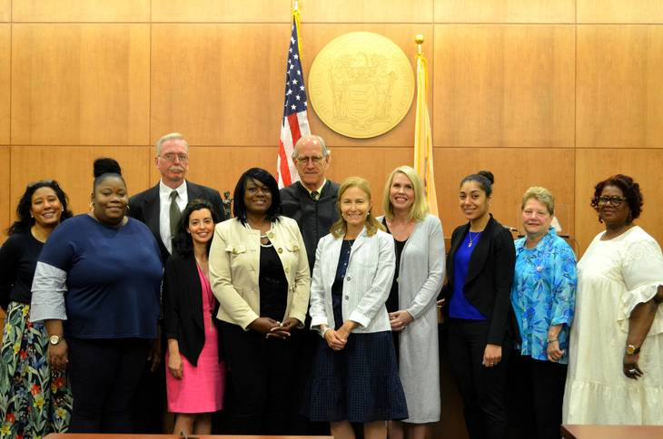 e8967fe36cd7f7a6ef78_CASA_Swearing_In_Group_With_Judge.JPG