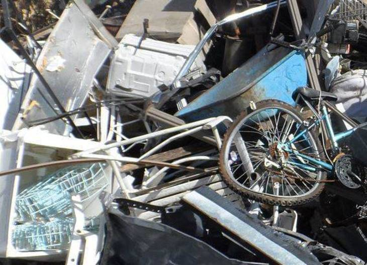 eab404d6dcf7f8499d19_Scrap_Metal_by_Mark_Buckawicki.JPG