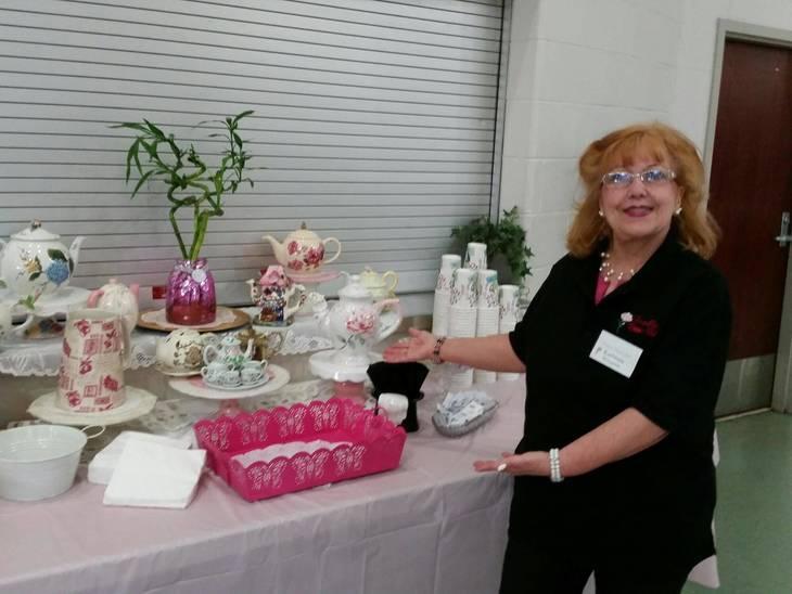 f0aa793226fd4aaf5555_Coffee___Tea_Table_w_Woman_s_Club_Member_Kathleen_Williamson.jpeg