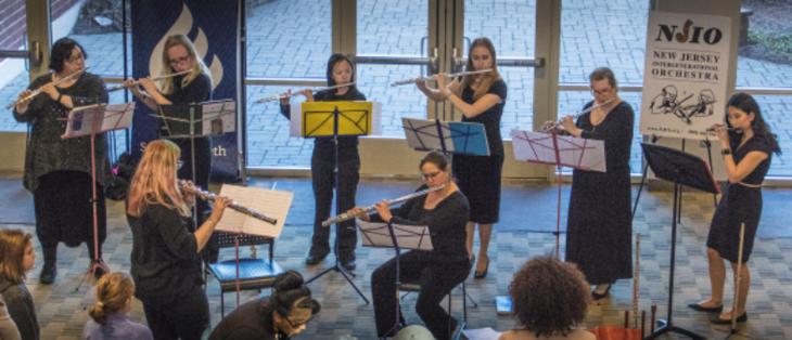f14f3f04aa934637177f_Photo_2_-_NJIO_s_Brand_New_Flute_Choir_Performing_During_Intermission.jpg