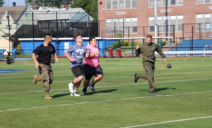 f4446f6cf65fa1810a13_EDIT_marines_encourage_runners.jpg