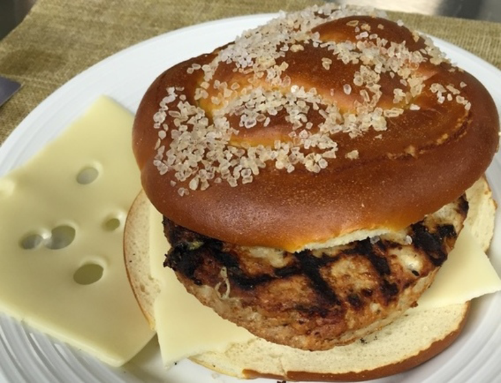 f61e809cd5d0765eb9d1_Turkey_Burger_on_Pretzel_Roll.jpg