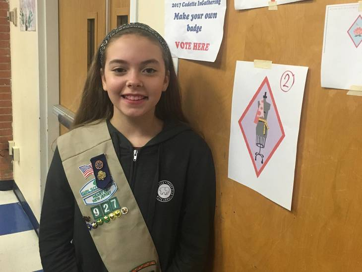 f6d0d58692294b66da7e_Badge_Winner_Olivia_Eckstine_beside_her_creation.JPG