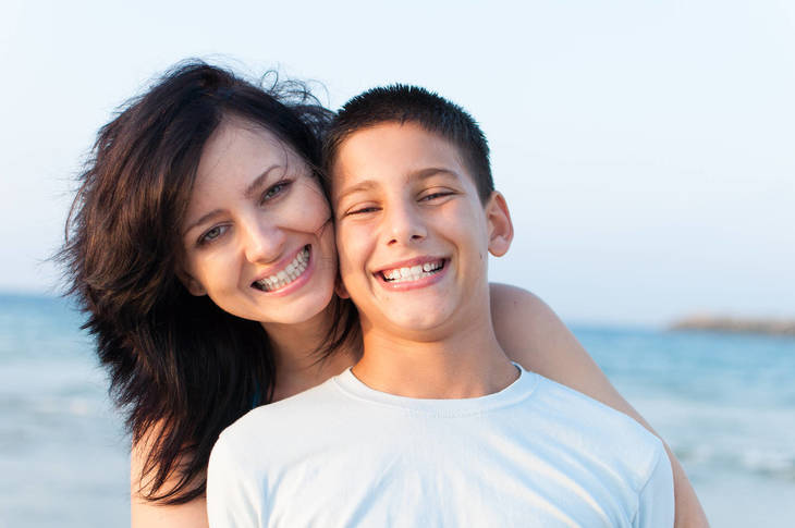 fb387083499206f6ce6c_bigstock-Mother-son-beach-84306422.jpg