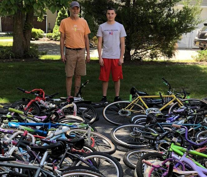 fe3105b09308746ec631_Alex_Iervolino_with_the_volunteer_from_Pedals_for_Progress_who_picked_up_the_43_bikes_he_collected_Courtesy_of_Mary_Iervolino____2._-_crop.jpg