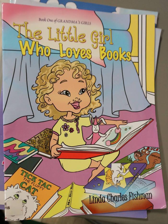 fe86c473cad66eb1712f_2_The_Little_Girl_Who_Loves_Books.JPG