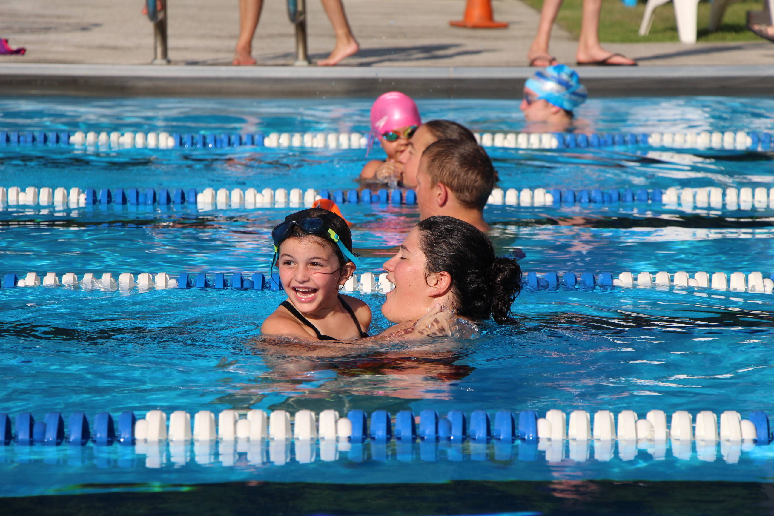 d315ae42b5a040682a13_EDIT_young_female_swimmer_with_catcher.jpg