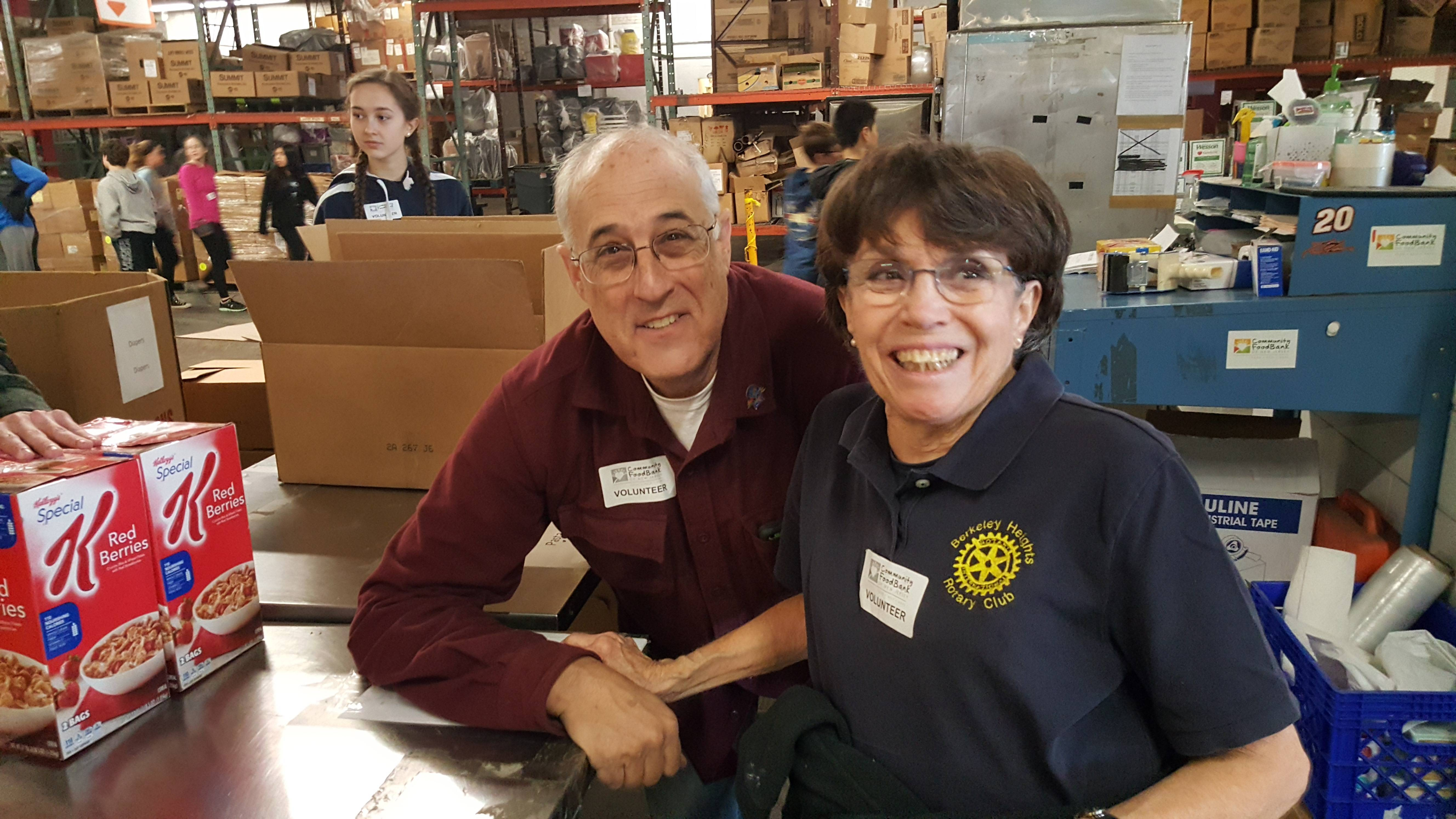 d487f8b53429bd6f4187_Pam_and_Gerry_at_Food_Bank.jpg
