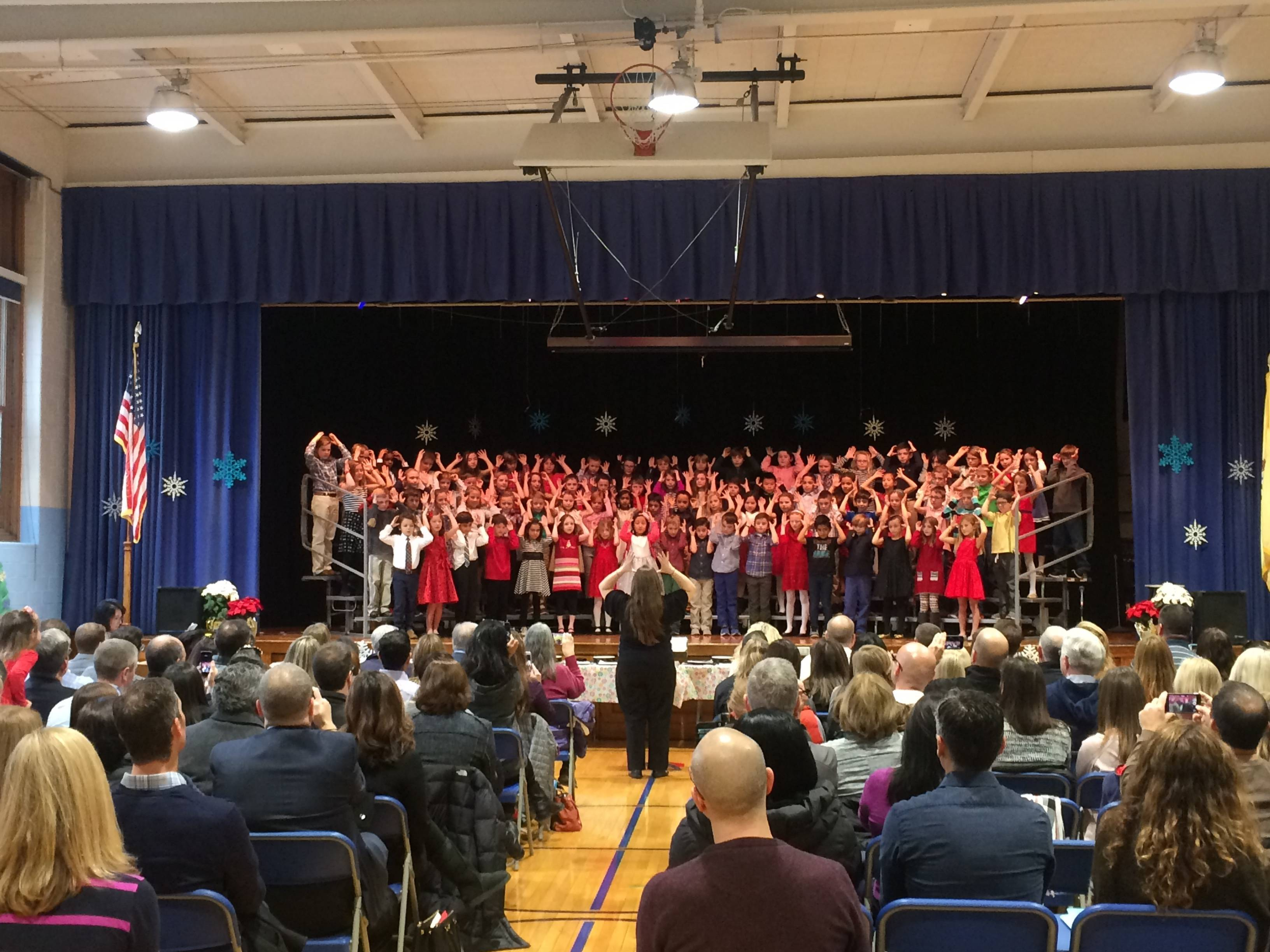 d5aa594ba1f4e002c44c_Milton_Avenue_School_s_3rd_graders_perform_under_Veronica_Shaw_s_direction.jpg