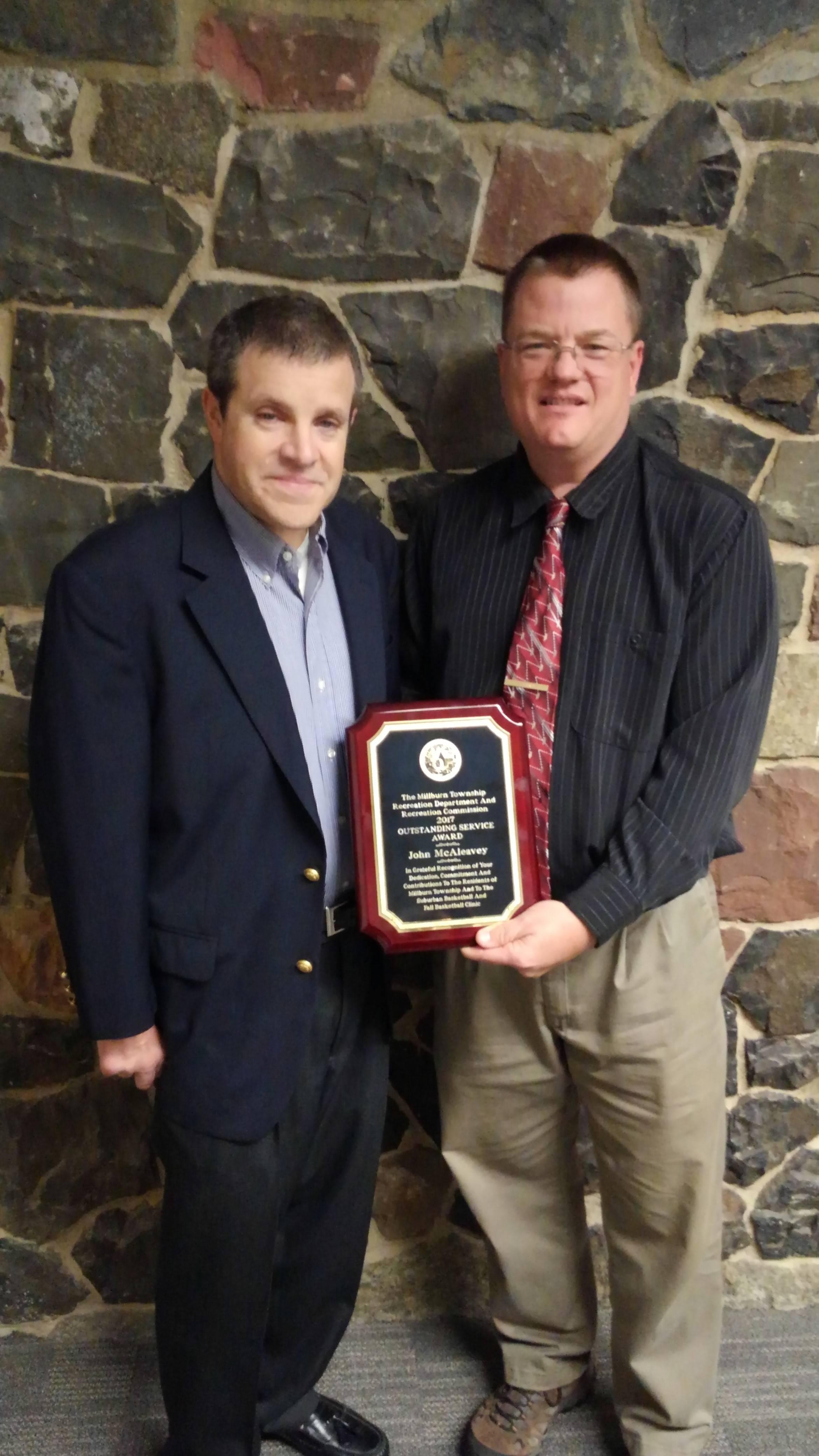 dcc0421a2c325b93af36_Outstanding_Service_Award_-_John_McAleavey_2017.jpg