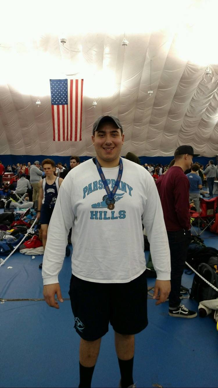 dcfd8903822d091e0f3d_Justin_Gurth_displays_the_medal_he_won_for_finising_third_at_the_Group_4_indoor_meet.jpeg
