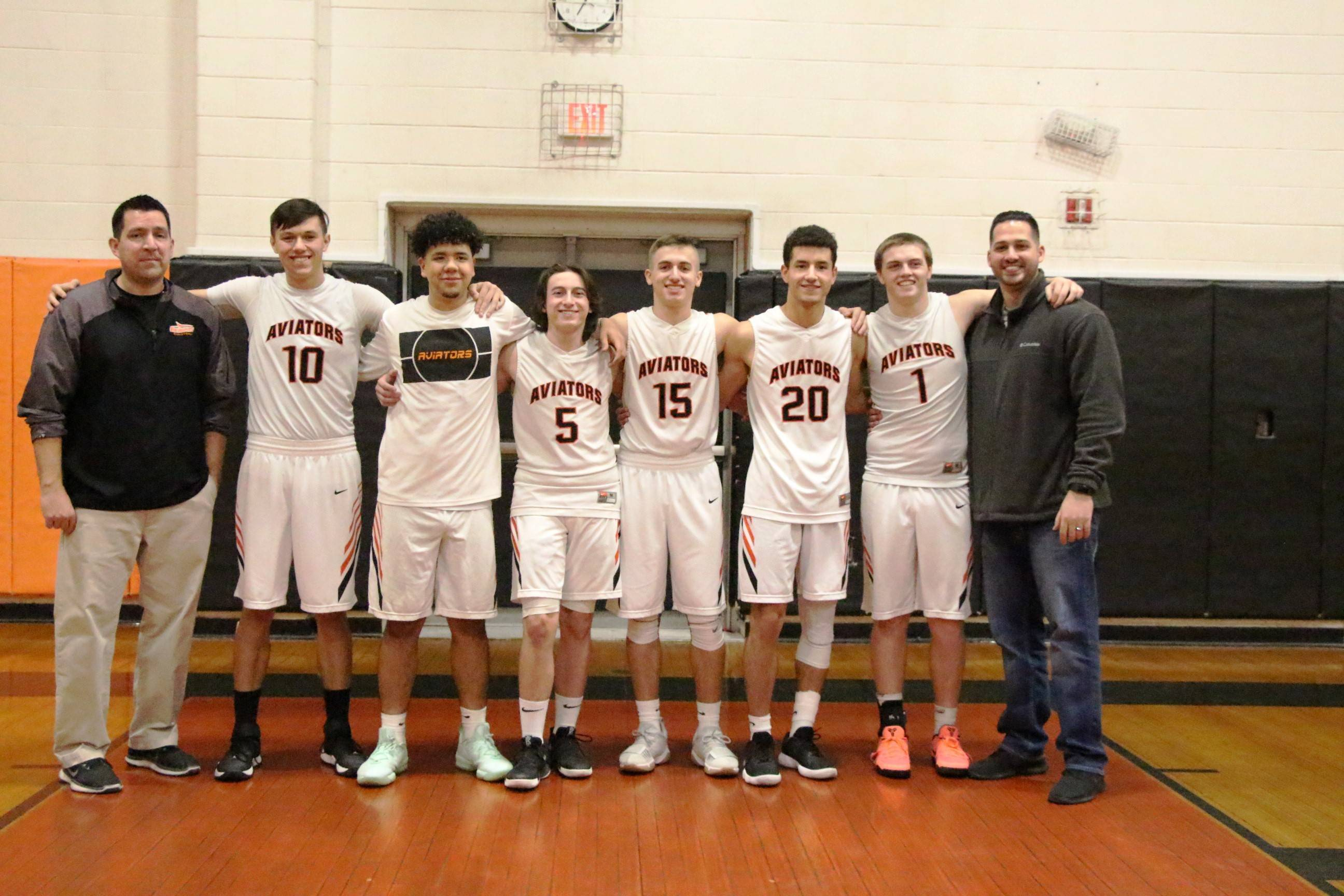 e7c77d220357cd752a2f_EDIT_seniors_and_coach_before_the_game.jpg
