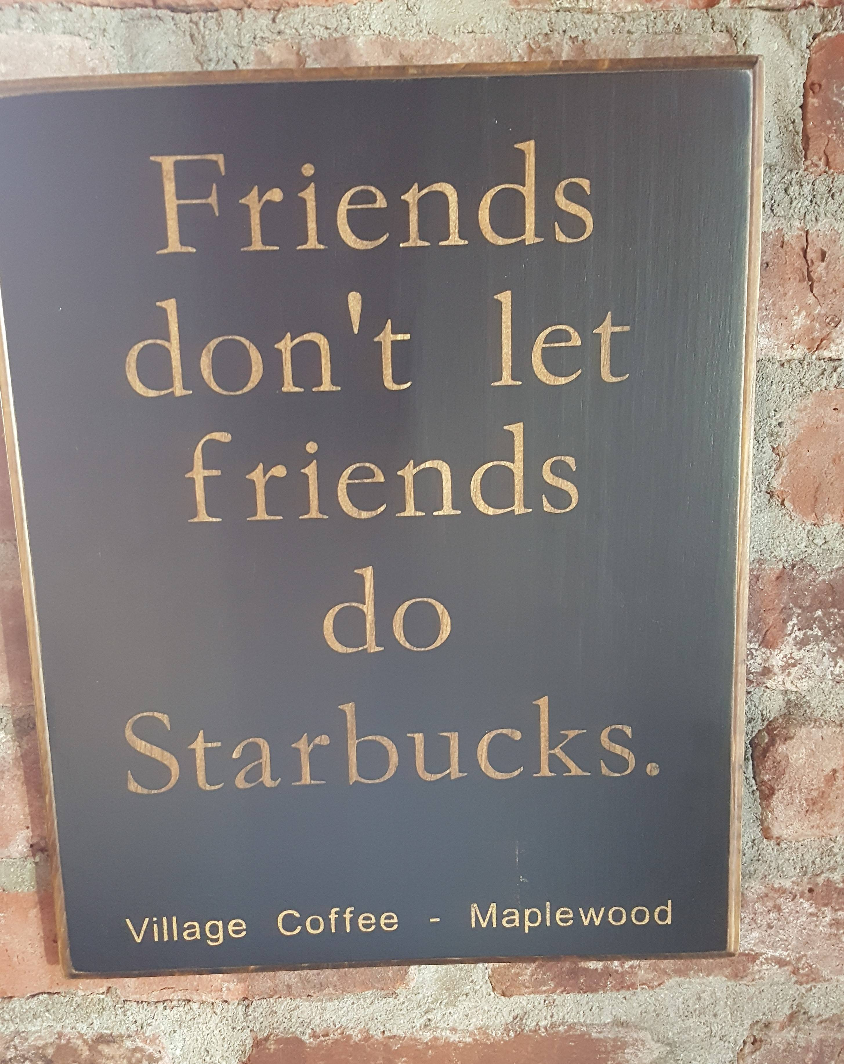 f1471740215dcd540160_starbucks_sign_village_coffee.jpg
