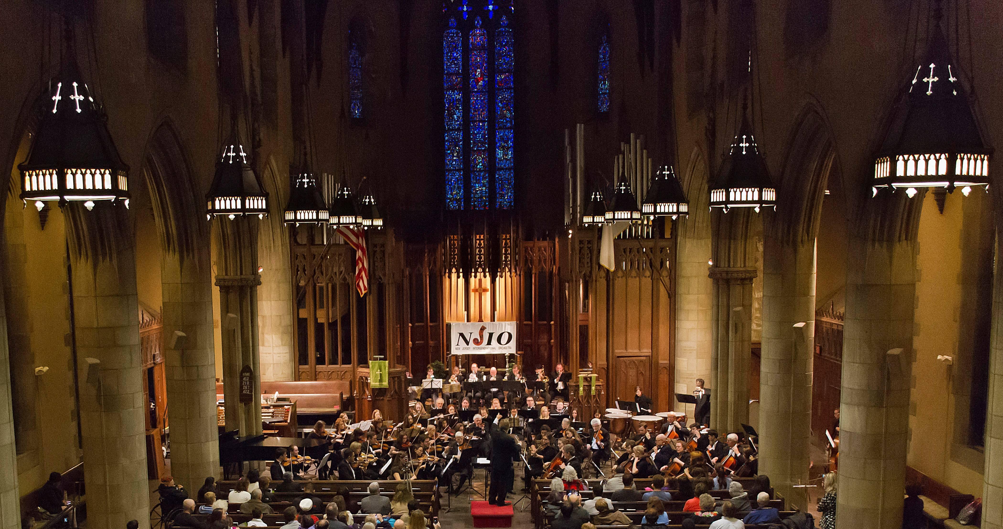 f9ae6a982371f052310c_Photo_2_-_NJIO_performing_in_Plainfield_s_magnificent_Crescent_Avenue_Presbyterian_Church.jpg
