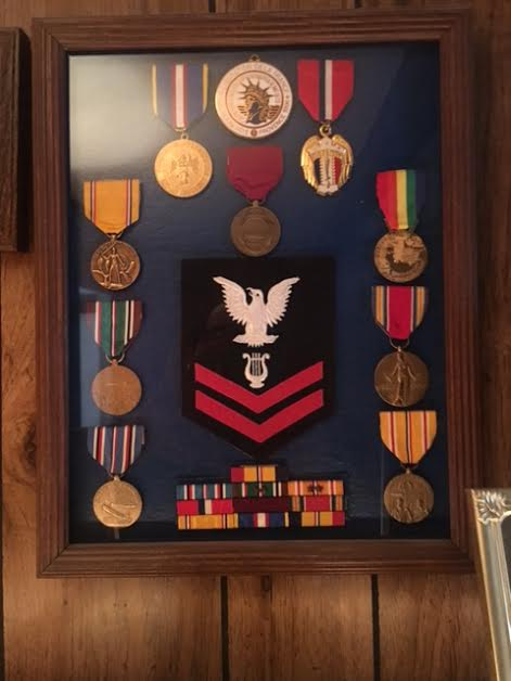 fd48d56d21ff492bc301_Ray_Medals.jpg