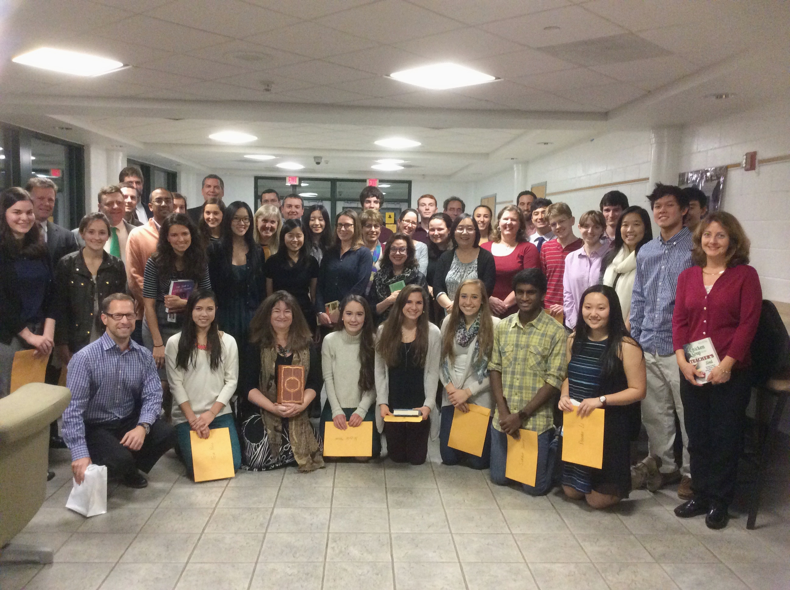 Summit High School students who have been named National Merit Scholars  presented books of their choosing to their favorite teachers.