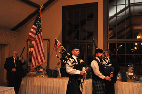 Pipers lead in the flag bearers.