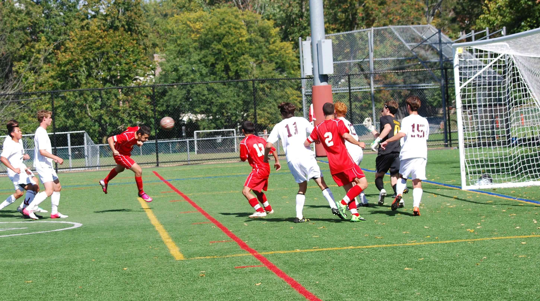 56d453abff965f96615e_2013_boys_soccer_varsity_marzo_header_goal_2-1.jpg