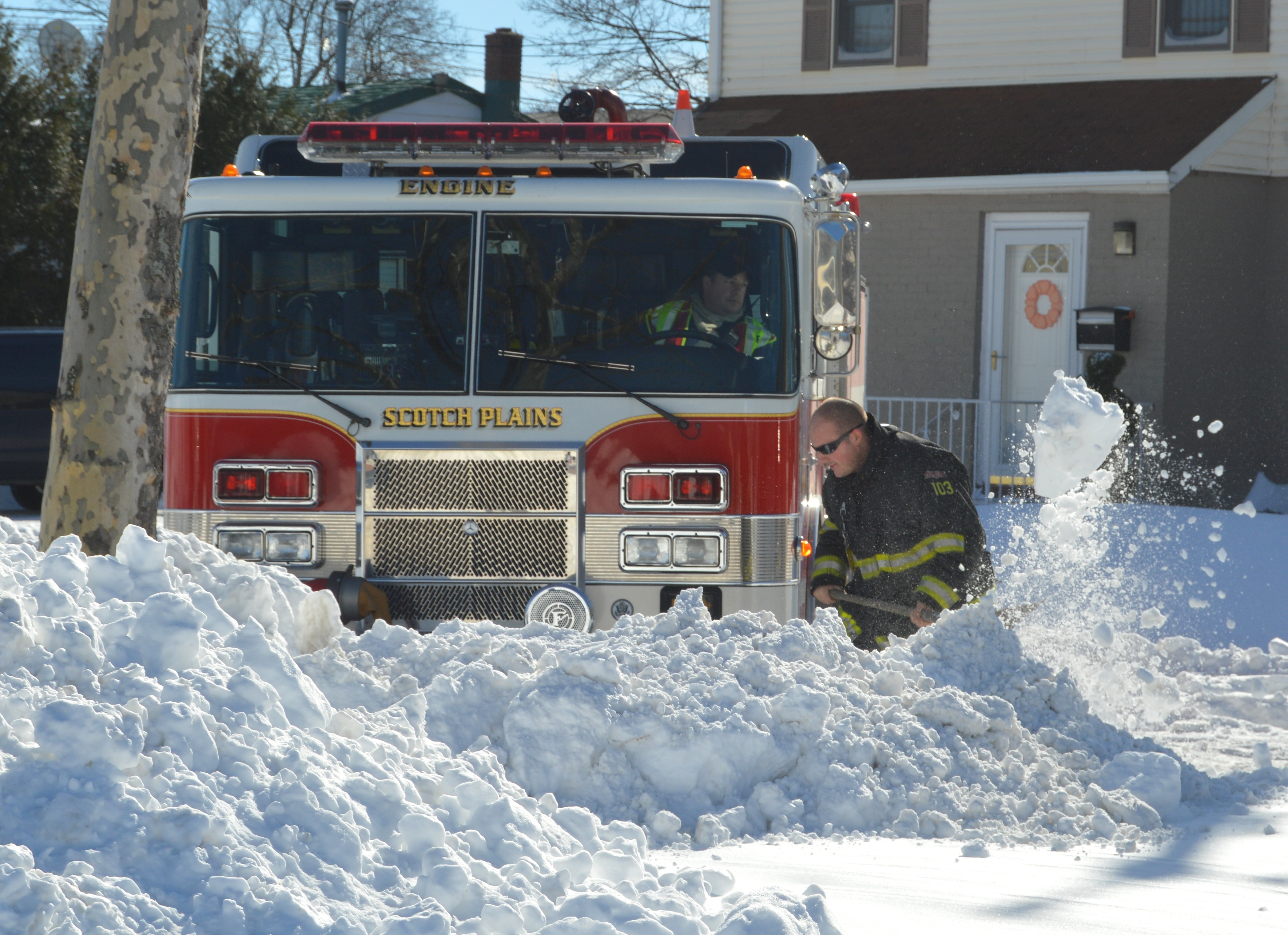 a5924601c886391f38d9_Firefighter_digs_out_rig_1-24-16.JPG