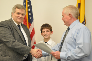 George Graham poses with grandson Seth Markle, age 11, of Netcong, and Sussex County Clerk Jeff Parrott, as he turns in his petition.