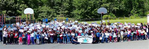 aa9f8e798526c8acbf05_Mt._Pleasant_Elementary_School_Poses_for_a_Picture_at_Annual_Carnival.jpg