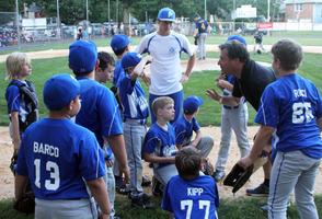 Coach Ed Zazzali helps gives a pep talk to the team