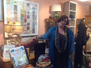 Robin Lennon poses with a number of her pieces.