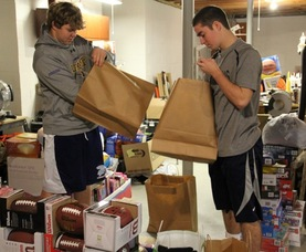 Cole Zugelder and Teddy Fischer Pack Gift Bags for 8th Grade Boys