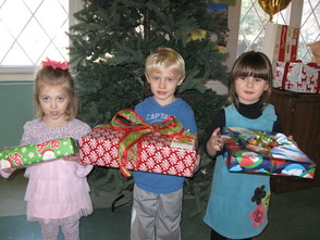 St. Andrew's Preschool & Kindergarten students Reese Donnelly, age 3, Ryan Leuenberger, age 5, and Alexandra Meredith, age 4, pictured here (left to right) got in the giving spirit as they helped with the effort
