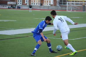 Joseph Rodriguez gets past a Millburn defender and looks to pass to a teammate.