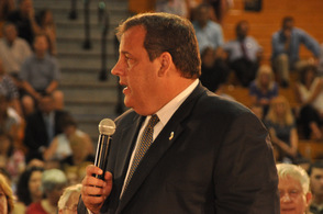 Governor Christie addresses audience members at the left side of the gymnasium.