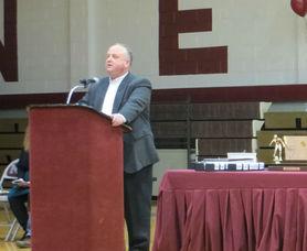 Principal Tasker addresses the crowd