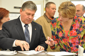 Sussex County Surrogate Gary Chiusano signs some documentation for Sussex County Deputy County Clerk Angela Rosa.