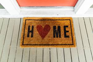 Carousel_image_033d7c02714f3271adf6_brown-home-printed-rug-beside-door-2949992__1_