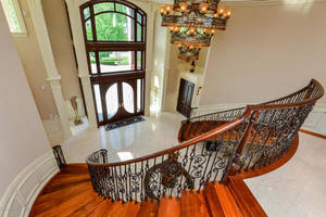 Mahogany Wood Stairs with Wrought Iron Baluster