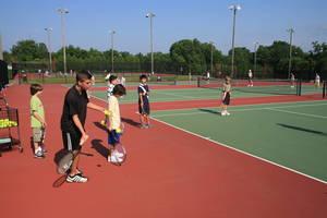 Carousel_image_0507c3312aa0f7512b47_tennis_lessons