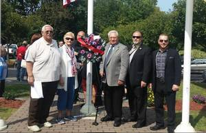 Carousel_image_11d63e94ed3edc0443b8_belleville_unico_911_wreath_laying_2017