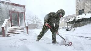 Carousel_image_1a0ea9ec5b609400a8a2_37888012-man-shovels-snow-0208-ap-jpg
