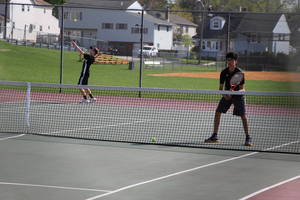 Carousel_image_1ada9f01f29a6a4e3be6_edit_first_doubles_serve