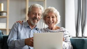 Person on Computer (couple smiling)