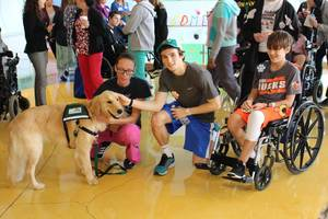 Carousel_image_3439641122956f16a5b2_burton_with_his_handler_katie_ahlers_and_children_s_specialized_hospital_patients_cameron_o_connell_19__and_aiden_kozack_12_pre