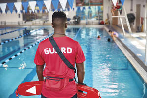 Lifeguard watches over the pool and swimmers.