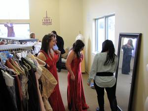 Carousel_image_4081cdfa87189f4e0f88_teen_girls_try_on_prom_dresses_at_the_sister_to_sister_prom_shop