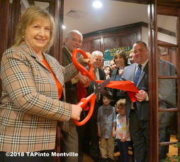 Carousel_image_476b697e2191470f7735_a_committee_member_june_witty_cuts_the_ribbon_at_margaret_miller_s__2nd_from_right__new_office__2018_tapinto_montville___4_