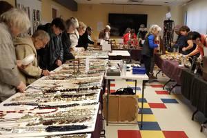 Customers shop at FOL jewelry sale.jpg